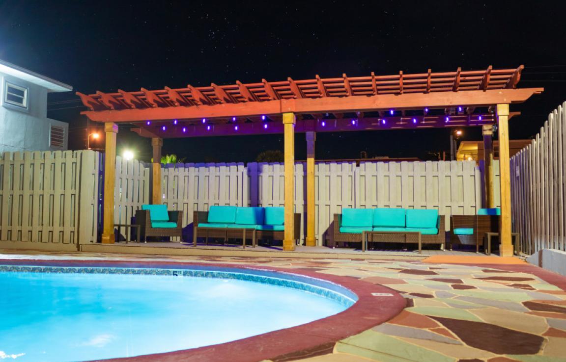 Poolside Pergola Seating Area at Night